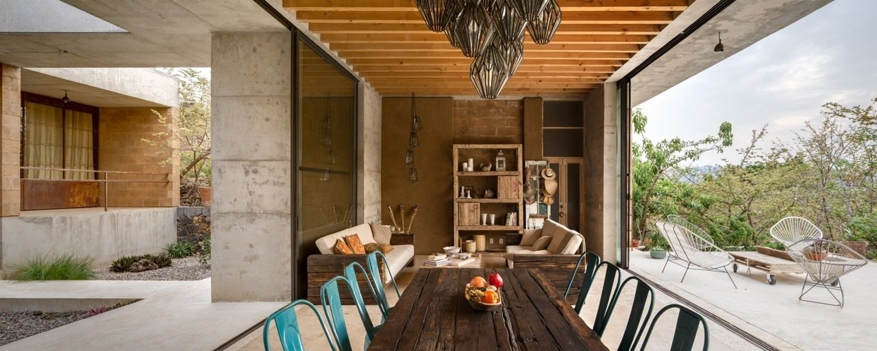 Thanks to the temperate climate, living and dining areas are able to be open to the surrounding environment.  Photo 6 of 8 in An Eco-Friendly Getaway Built With the Future in Mind