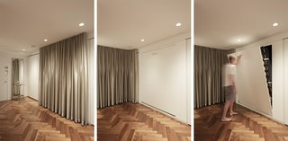 In Just 450 Square Feet, A New York Architect Crafts a Multifunctional Apartment of His Own - Photo 7 of 10 - A built-in track allows the KnollTextiles curtains to be moved in front of the entrance, creating a cozy bedroom space. A queen-size Häfele Murphy bed is hidden between two sets of Poliform cabinets.