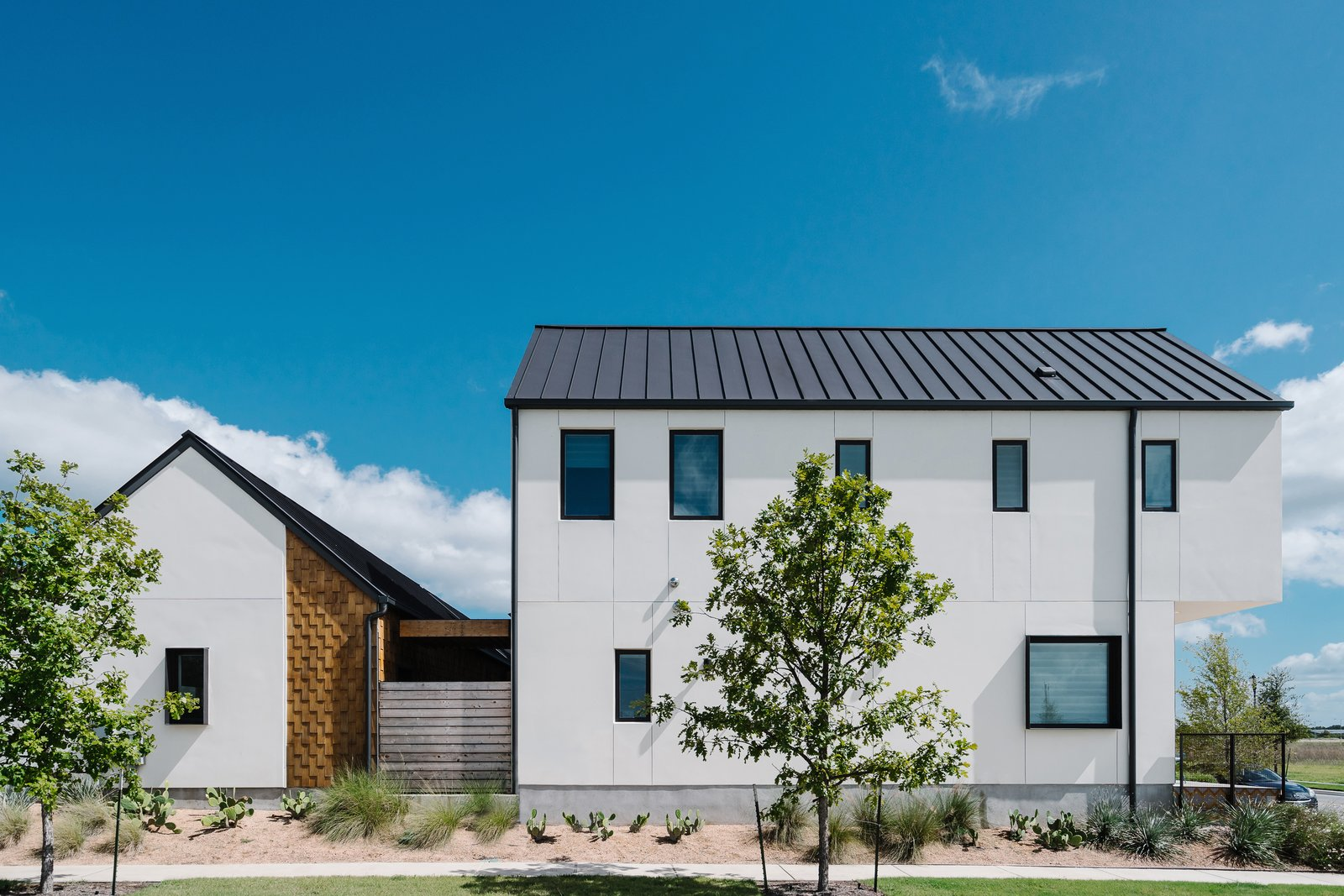 Outdoor At the back of the houses, cedar shingles provide an unexpected moment of visual interest.  Photo 2 of 7 in Sustainability is the Centerpiece of This New Austin Development