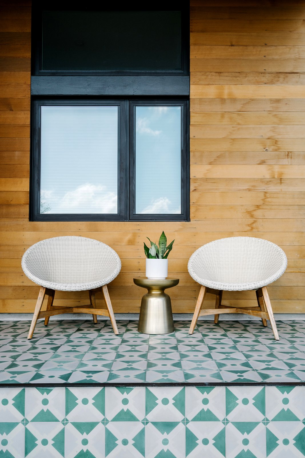 While the structures are virtually identical, details like the colorful tiles on the porch set each house apart from its neighbors. Tagged: Outdoor.  Photo 4 of 7 in Sustainability is the Centerpiece of This New Austin Development