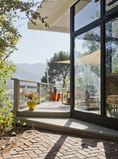 """Every single room in the house connects to the outside,"" Lara says. ""Being New Yorkers who moved to California, feeling like we were living in the mountain was huge for us. Our deck really is an extension of the living room."""
