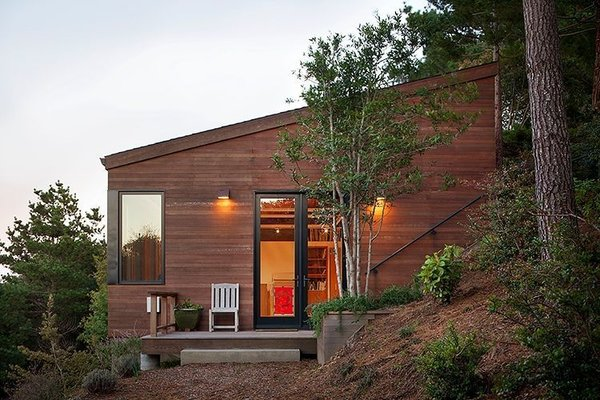 The approximately 1,800-square-foot studio is clad in redwood to match the ochre terrain; its angled roof defers to the hill's incline. The windows are from Blomberg Window Systems.  Photo 3 of 4 in The View at This Art Studio Could Inspire a Masterpiece