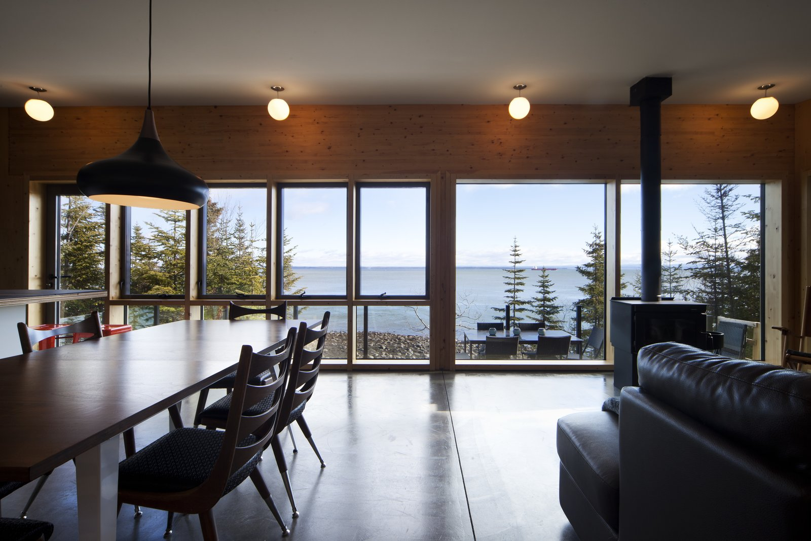 Dining Room, Table, Pendant Lighting, and Chair  Photo 1 of 4 in The St. Lawrence River Flows Right by This Cottage's Doorstep