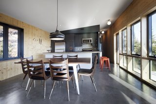 Materials throughout the house are elemental, befitting its wilderness setting. The walls are made of cross-laminated timber and the floors are slabs of heated concrete.