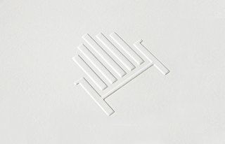 The silhouette of an Adirondack chair, seen here on embossed stationery, references the store's resort town setting.