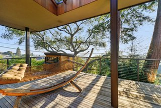 The home's deck extends outward toward a vista. General contractor McCutcheon Construction was tasked with improving insulation and installing double-pane windows throughout.