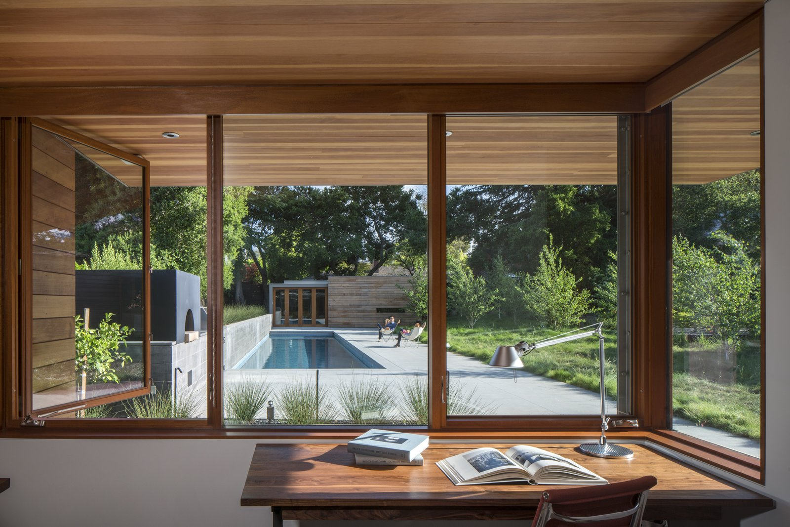 Outdoor, Small Pools, Tubs, Shower, Lap Pools, Tubs, Shower, and Concrete Patio, Porch, Deck The study faces the pool area.  Photo 4 of 8 in Channeling Midcentury Modern in Northern California