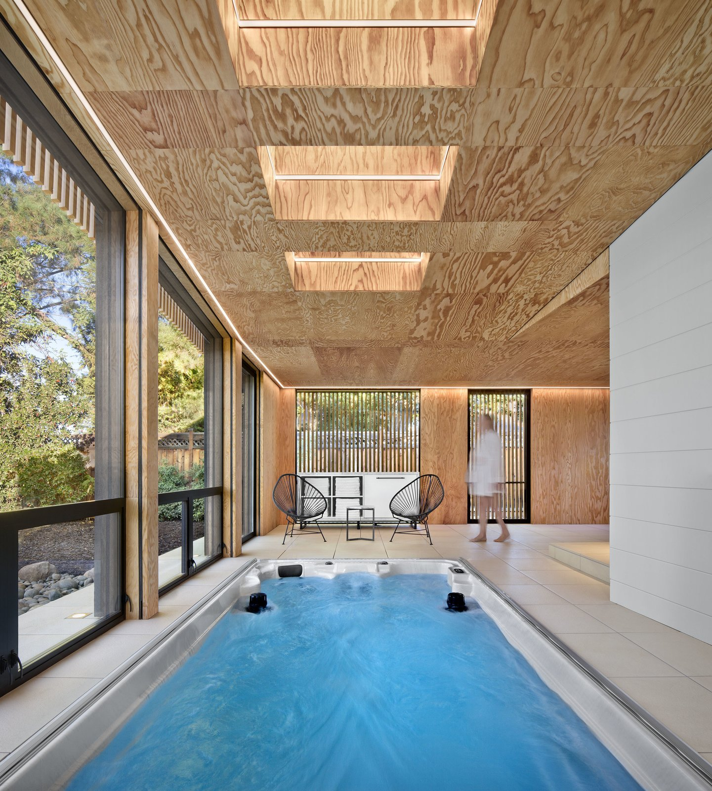 Outdoor and Lap Pools, Tubs, Shower The addition's roofline rises northward to capture daylight through a series of operable skylights.  Photo 2 of 4 in Cling to Summer a Little Longer at This Indoor Oasis