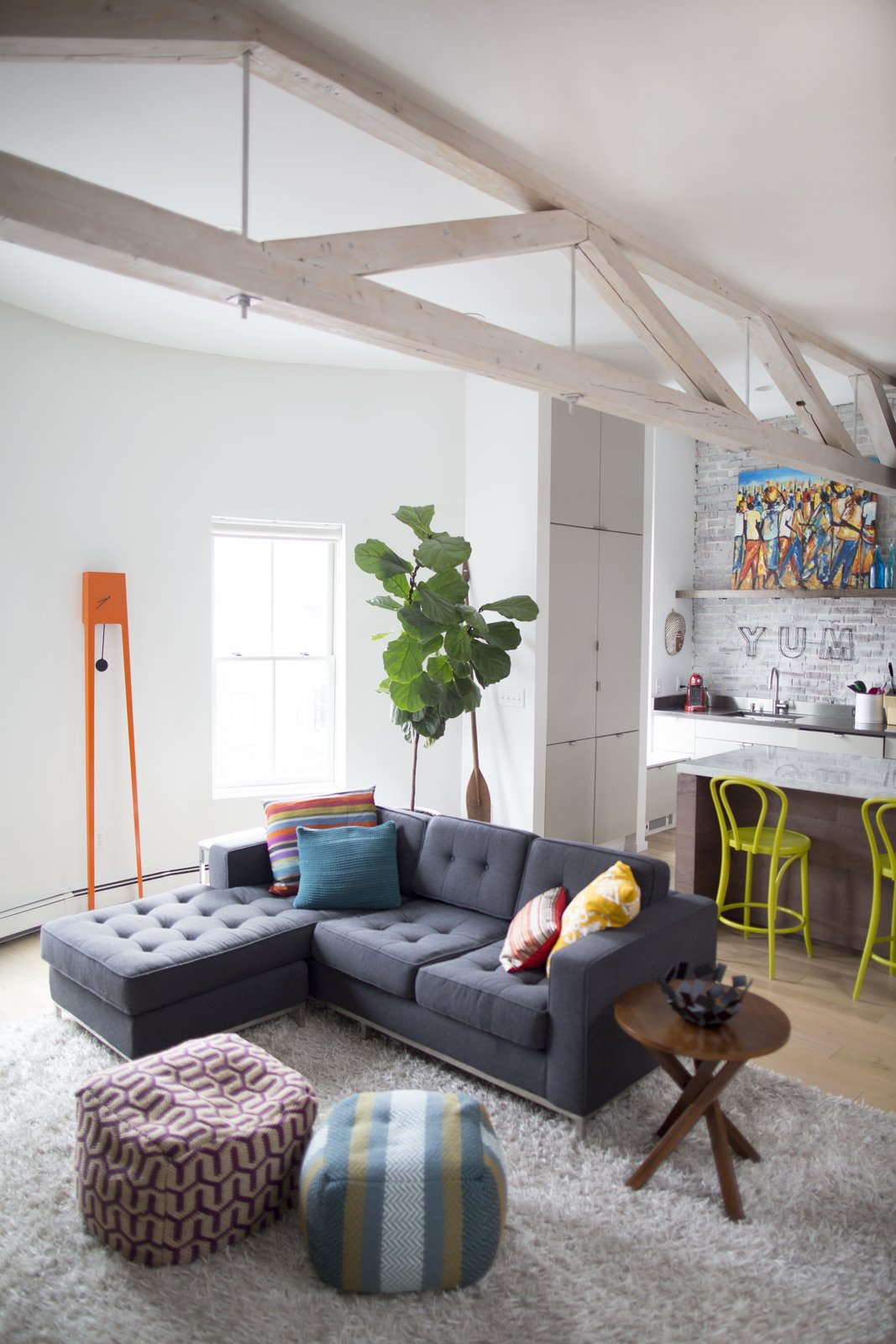 Living Room, End Tables, Sofa, and Light Hardwood Floor The living room features an eye-catching Tiuku grandfather clock by Covo. The Gus sofa is from Lekker.  Photo 3 of 5 in This Modern Boston Renovation Expertly Mixes in Colorful Craft Finds