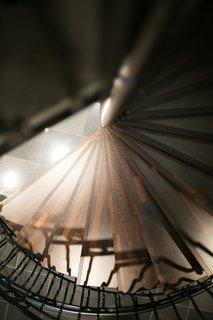 The dramatic spiral staircase was handmade by Voitto Mustakallio in Nurmijärvi, Finland.
