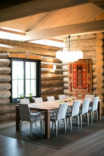 A traditional tapestry and other textile accents warm the home. The chandelier is by Kalmer.