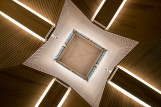The cathedral-like, wood-paneled ceiling makes a big impression in the foyer.