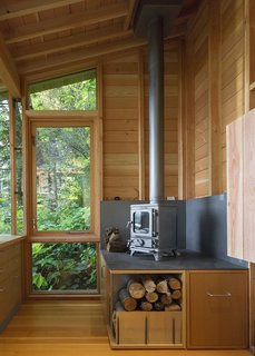 While the space is heavily insulated, with strong solar gain, a cast-iron stove from Salamander Stoves provides extra warmth on cool days.
