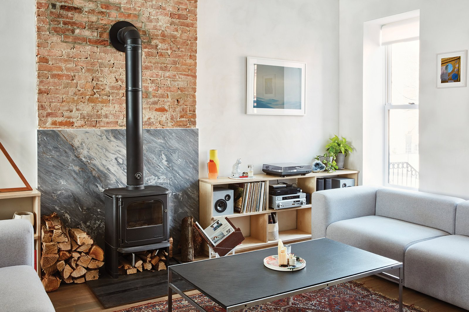 The first floor holds the living room, which includes a Morsø 3440 wood-burning stove and a pair of Mags sofas by HAY.  Photo 4 of 16 in Forever Changes