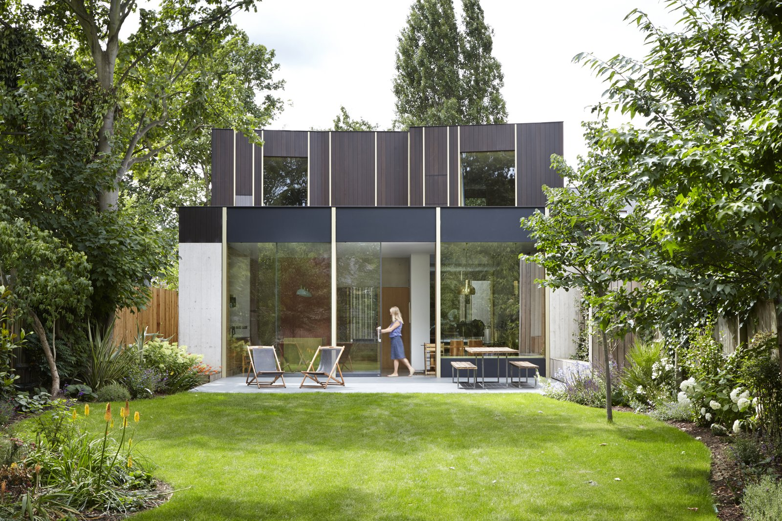 Exterior and House Building Type Landscaping was designed by Gardenia Gardens.  Photo 3 of 9 in This Modern Courtyard Home Celebrates a 100-Year-Old Tree