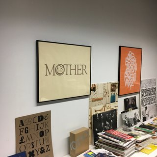 "Shot taken within the Herb Lubalin Study Center the original ""Mother & Child"" logo, to the right ""ABCDEFG..."" the alphabet set in Avant Garde Gothic, designed by Herb Lubalin and Tom Carnase. One of many examples of typically Lubalin-esquen arrangement of interlocking and overlapping letterforms. 1974"