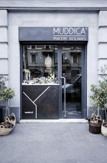 Previously a tailor's shop located in the heart of Milan, Muddica has been converted into a restaurant, bar, and Sicilian deli.