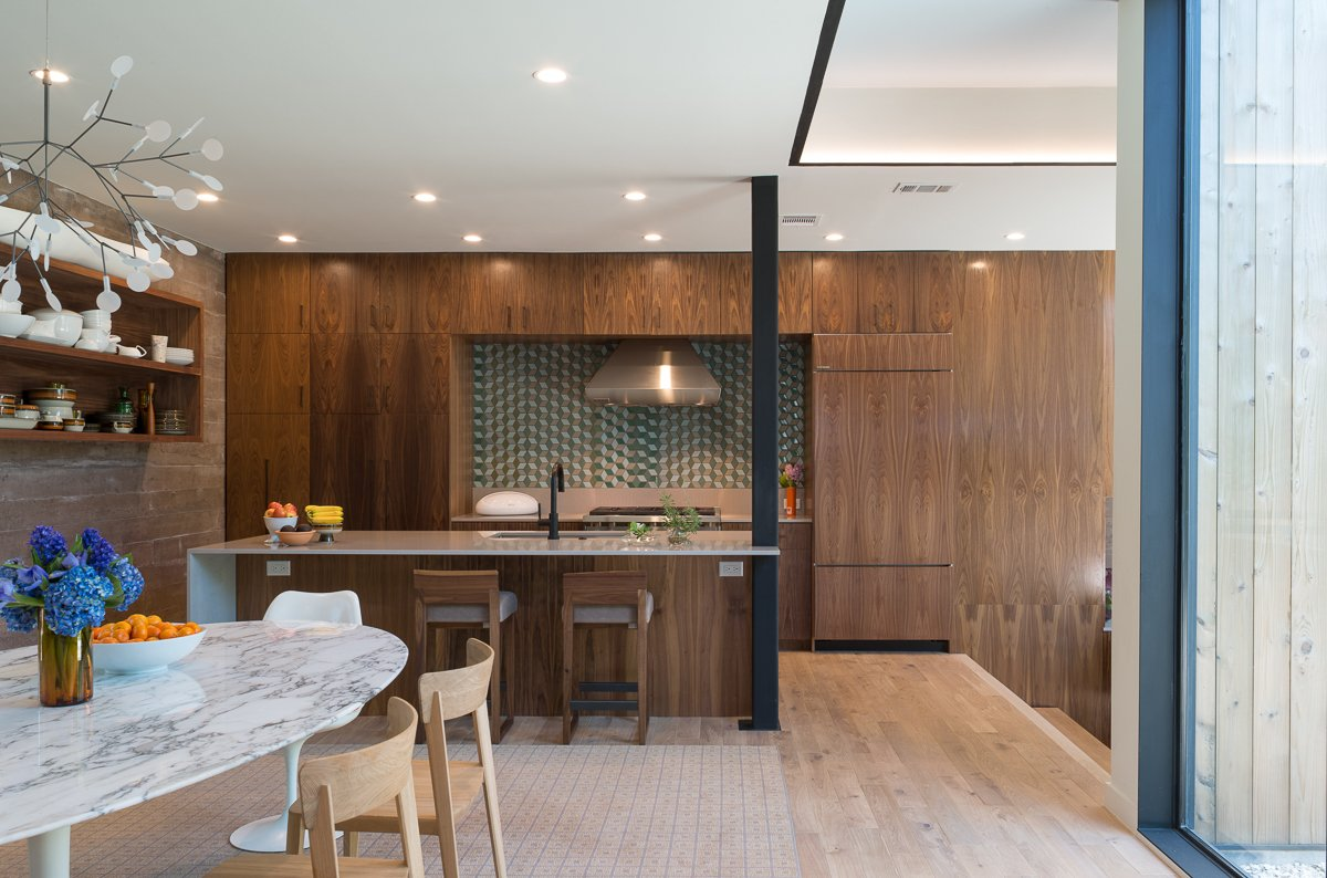 Kitchen, Light Hardwood Floor, Marble Counter, Ceramic Tile Backsplashe, and Wood Cabinet  Tetra House by Bercy Chen Studio