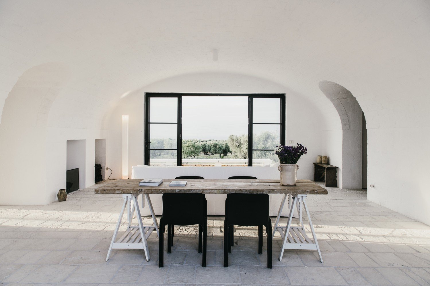Dining Room, Chair, Table, and Limestone Floor  Photo 3 of 11 in 10 Exquisitely Modern Homes in Italy from Masseria Moroseta by Andrew Trotter