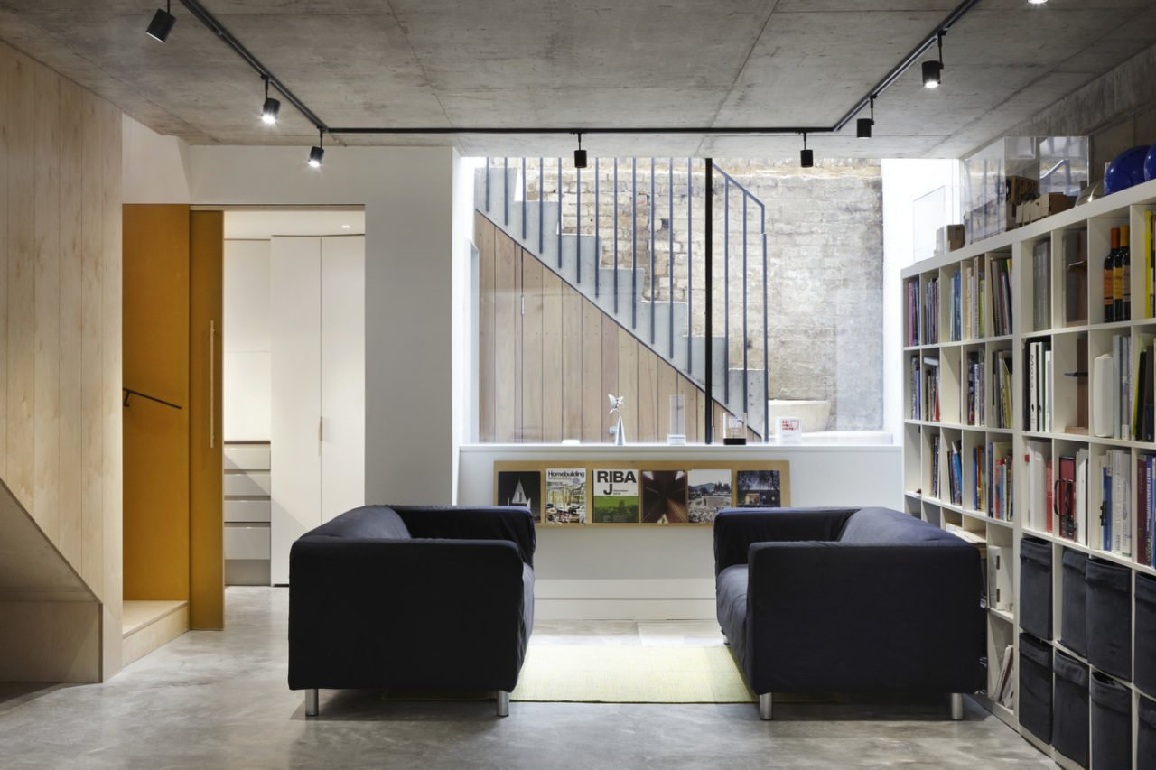 Living Room, Sofa, Concrete Floor, Bookcase, and Track Lighting  Photo 5 of 5 in Godson St by Edgley Design