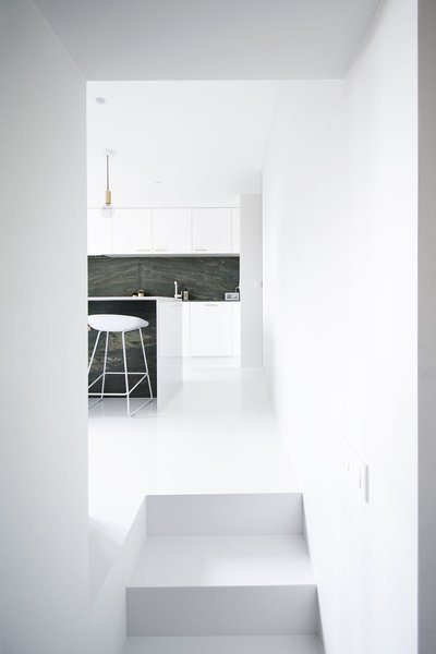 Kitchen, White Cabinet, and Pendant Lighting  Photo 2 of 11 in 10 Minimalist and Monochromatic Homes in Belgium from Niels & Annemie by Benoît Deneufbourg and la fabrika studio