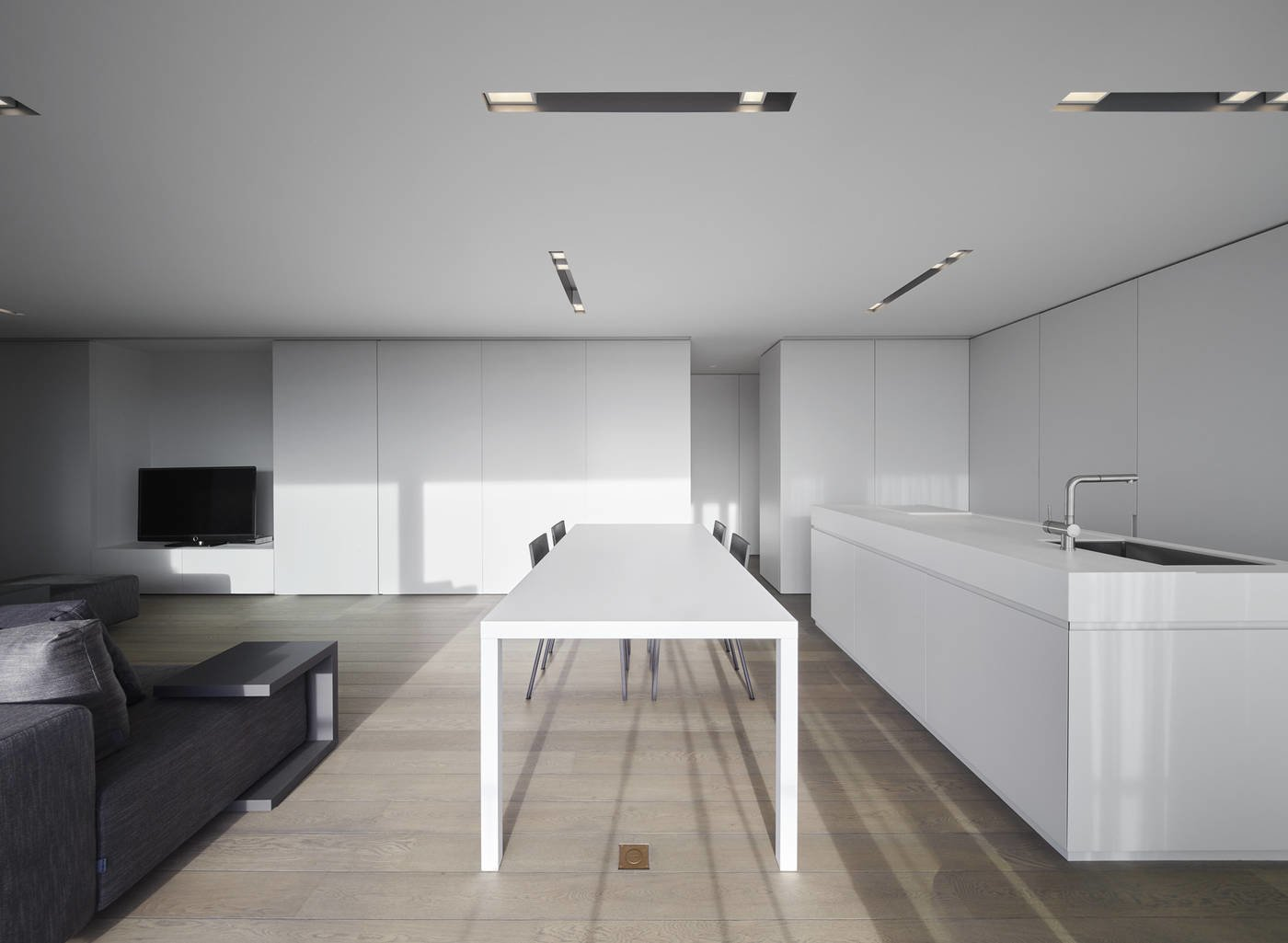 Dining Room, Ceiling Lighting, Recessed Lighting, Table, Light Hardwood Floor, and Chair  Photo 7 of 11 in 10 Minimalist and Monochromatic Homes in Belgium from Oostduinkerke by minus