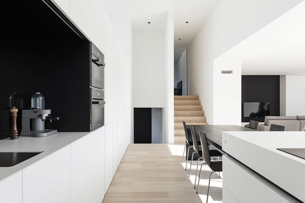 Kitchen, White Cabinet, Light Hardwood Floor, and Wall Oven  Photo 4 of 11 in 10 Minimalist and Monochromatic Homes in Belgium from Home DW by Francisca Hautekeete