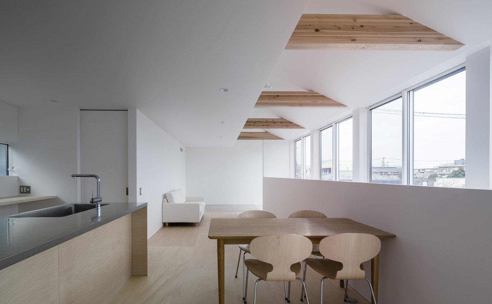 Dining Room, Light Hardwood Floor, Chair, Recessed Lighting, and Table  Photos from House in Futako by Yabashi Architects & Associates