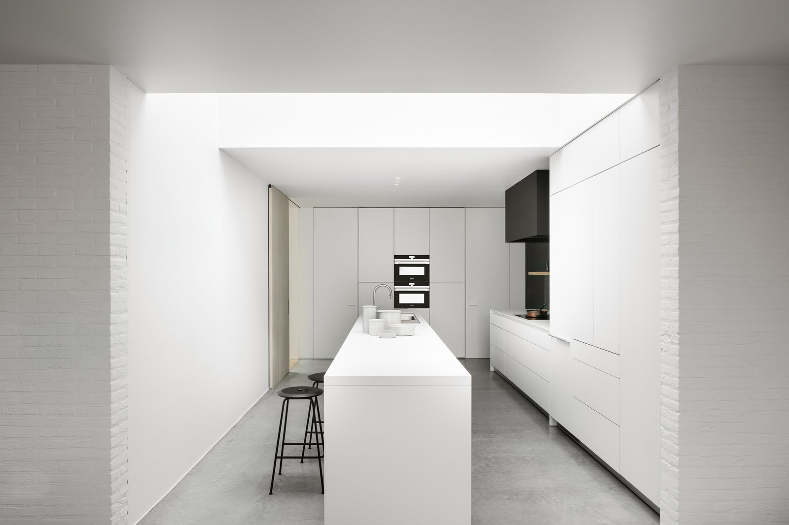 White Cabinet, Range Hood, Wall Oven, Windows, and Skylight Window Type  Photos from Kitchen and More by Vincent Holvoet