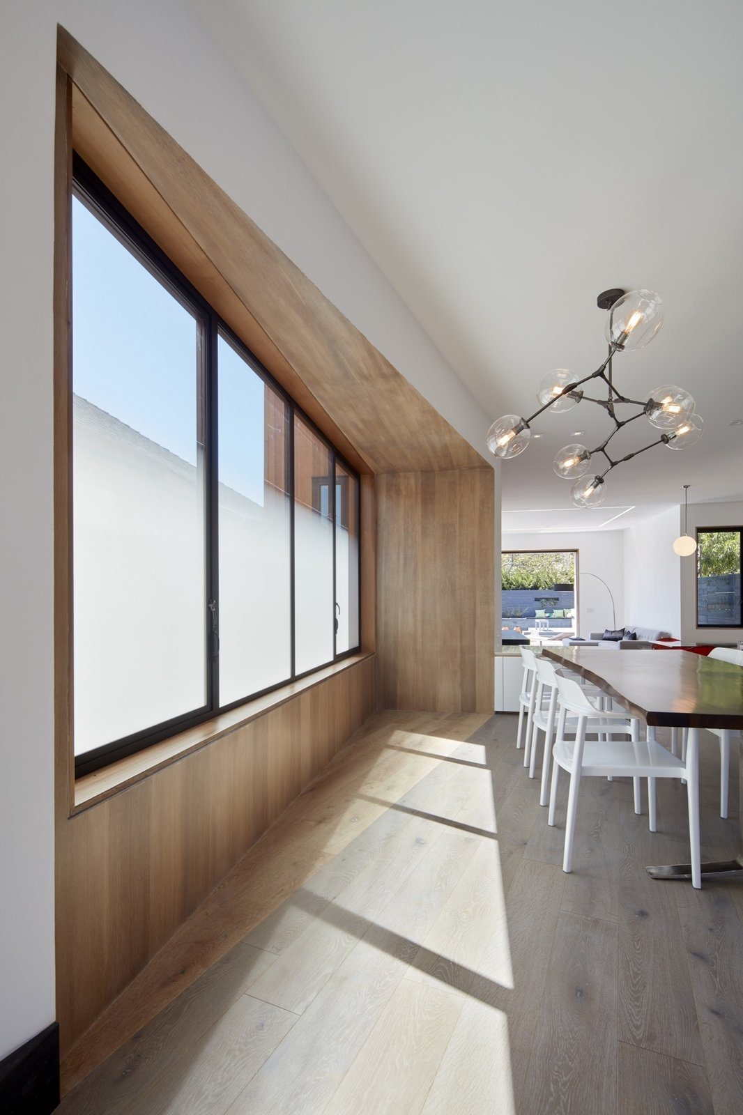 Dining Room, Chair, Pendant Lighting, Table, Accent Lighting, and Light Hardwood Floor  Noe Valley House