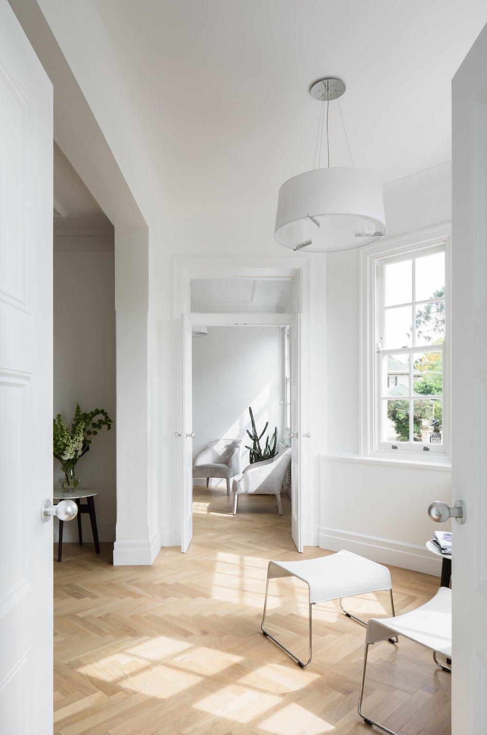 Living Room, Light Hardwood Floor, Chair, and Pendant Lighting  K Apartment