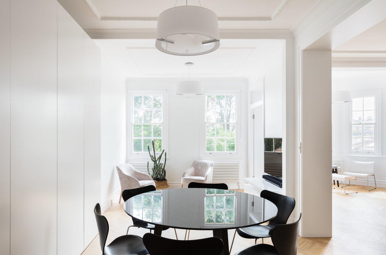 Dining Room, Chair, Pendant Lighting, Table, and Light Hardwood Floor  K Apartment