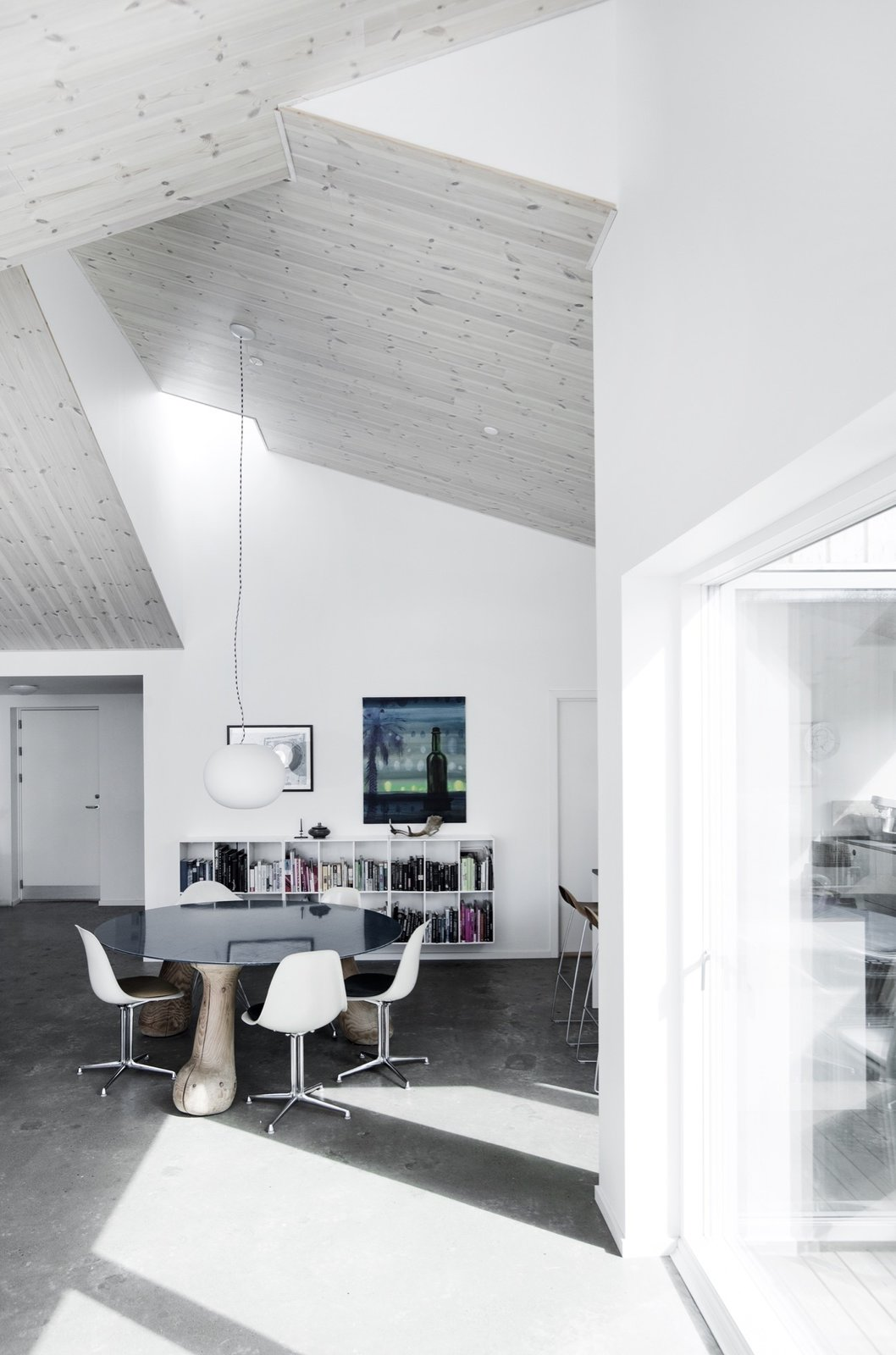 Living Room, Concrete Floor, Chair, and Pendant Lighting  The Roof House