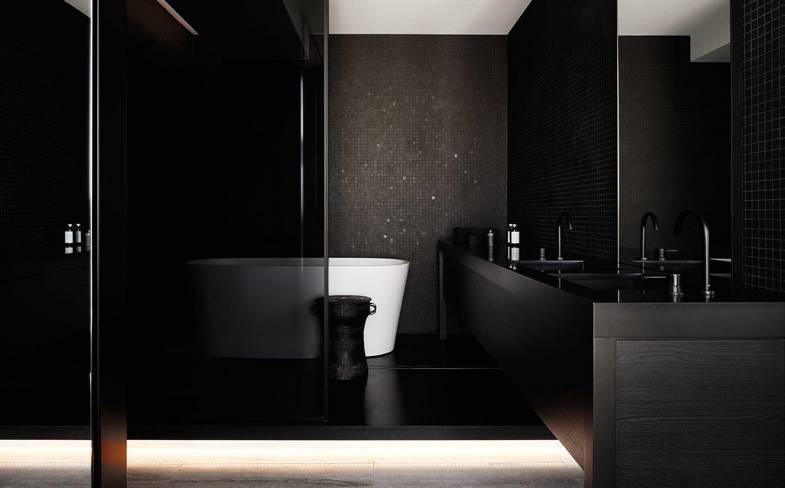 Bed, Medium Hardwood Floor, Laminate Counter, Wood Cabinet, Sofa, Bath Room, and Track Lighting  Darling Point