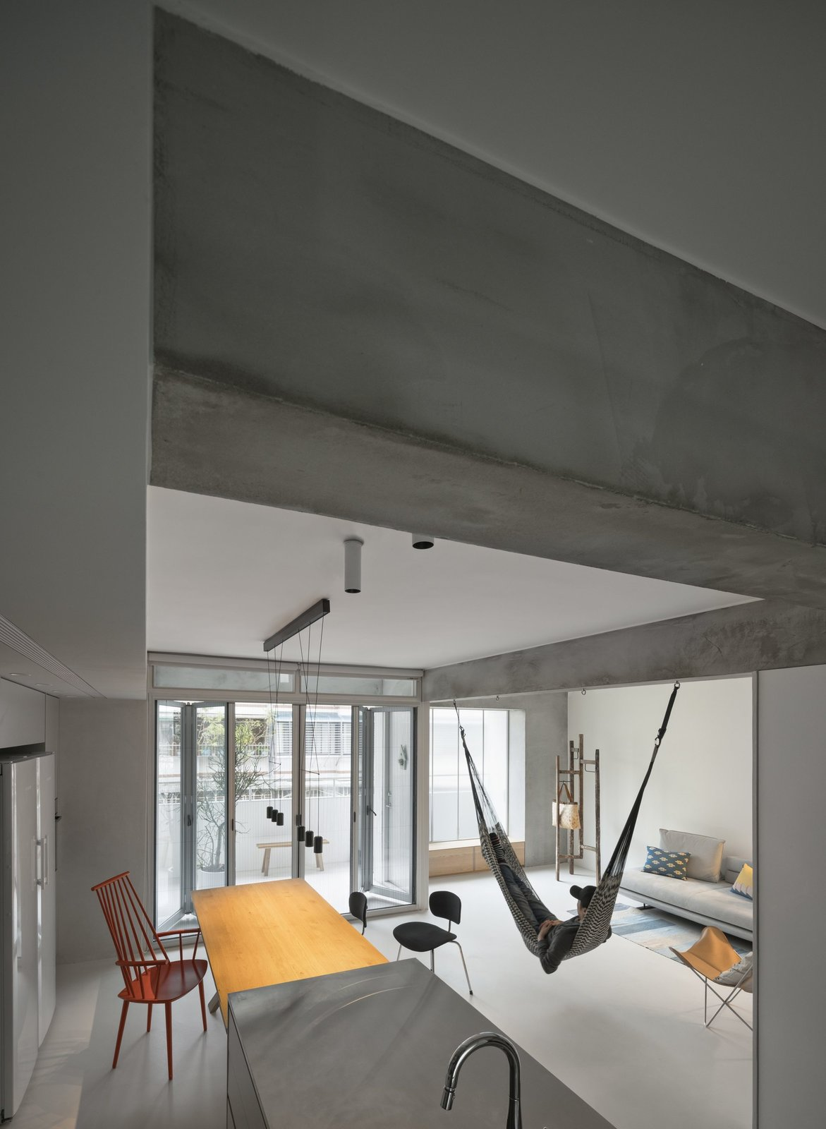 Chair, Vessel Sink, Ceramic Tile Floor, Concrete Counter, Drop In Tub, Recessed Lighting, and Living Room  Backlight Apartment