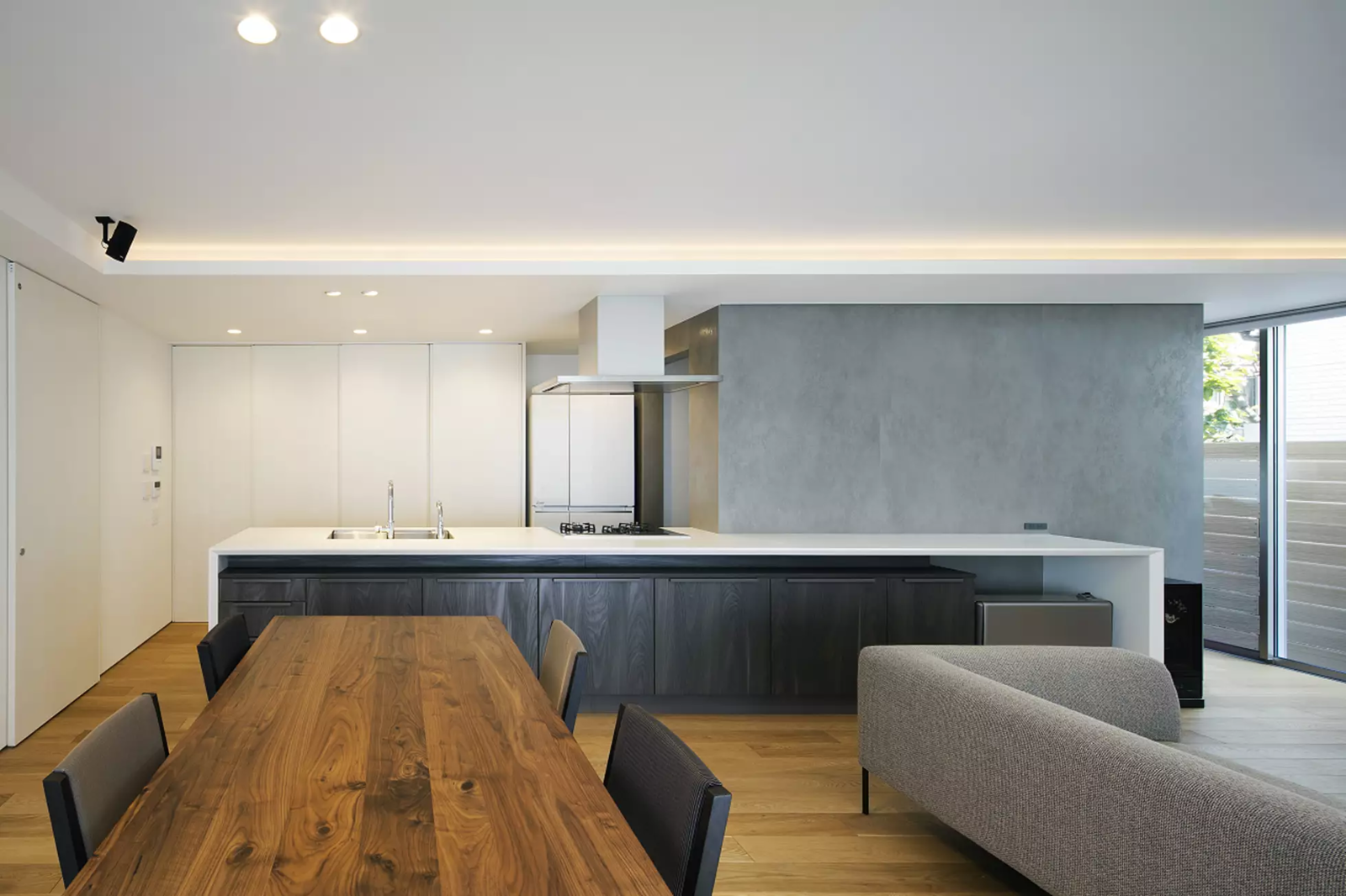 Kitchen, White Cabinet, Light Hardwood Floor, Recessed Lighting, and Drop In Sink  House in Mihara