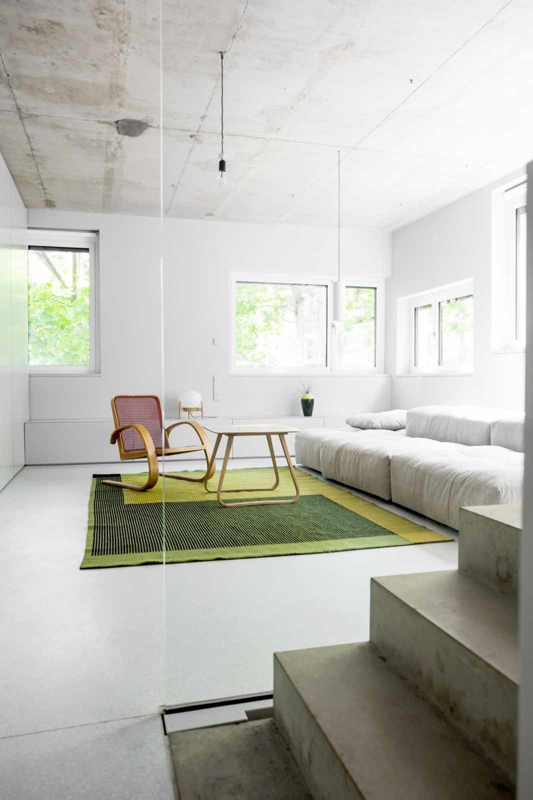 Living Room, Chair, and Concrete Floor  House on Prenzlauer Berg