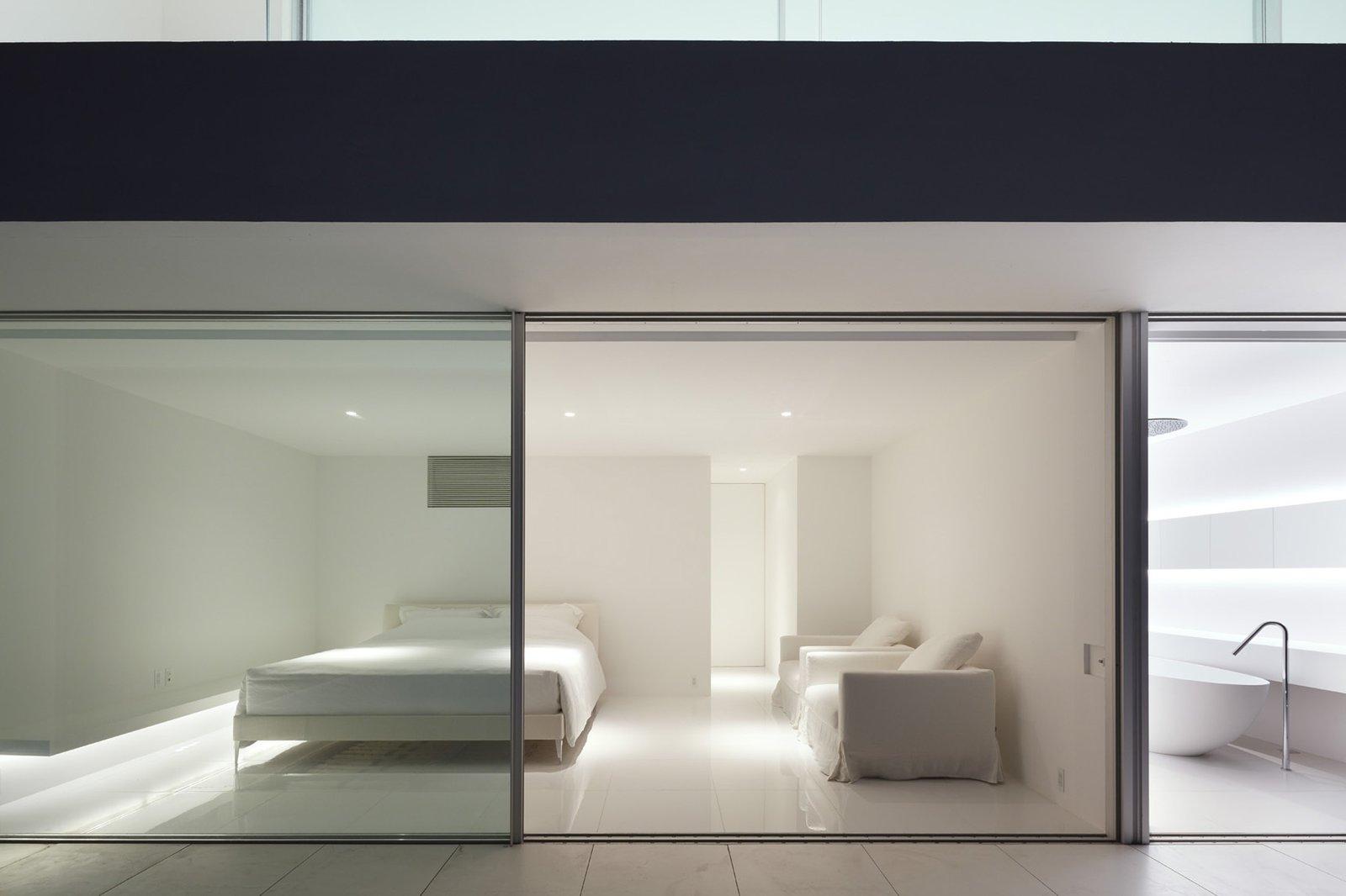Bedroom, Bed, Recessed Lighting, and Ceramic Tile Floor  Seaside House