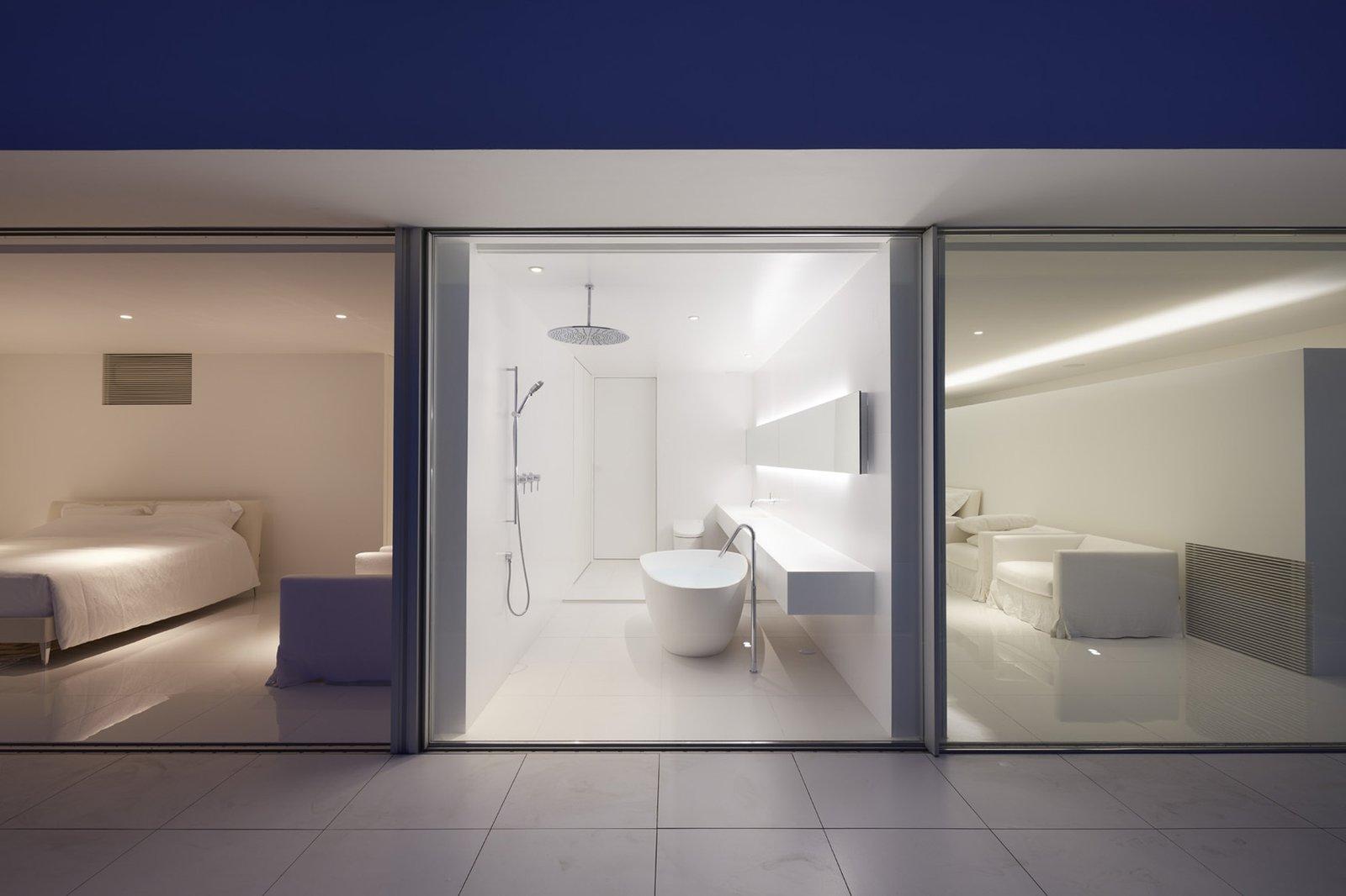 Bath Room, Freestanding Tub, Open Shower, Ceramic Tile Floor, and Granite Counter  Seaside House