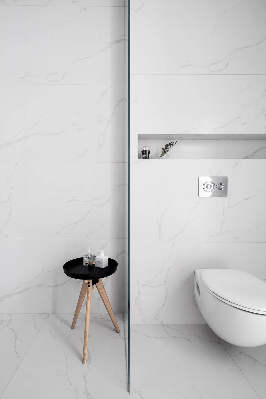 Bath Room, One Piece Toilet, Marble Wall, and Marble Floor  S|H Apartment