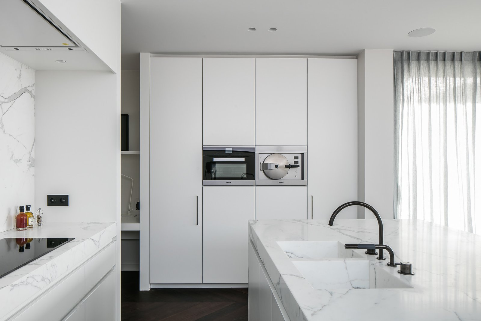 Kitchen, Marble Counter, Marble Backsplashe, Recessed Lighting, and Wall Oven  Penthouse O