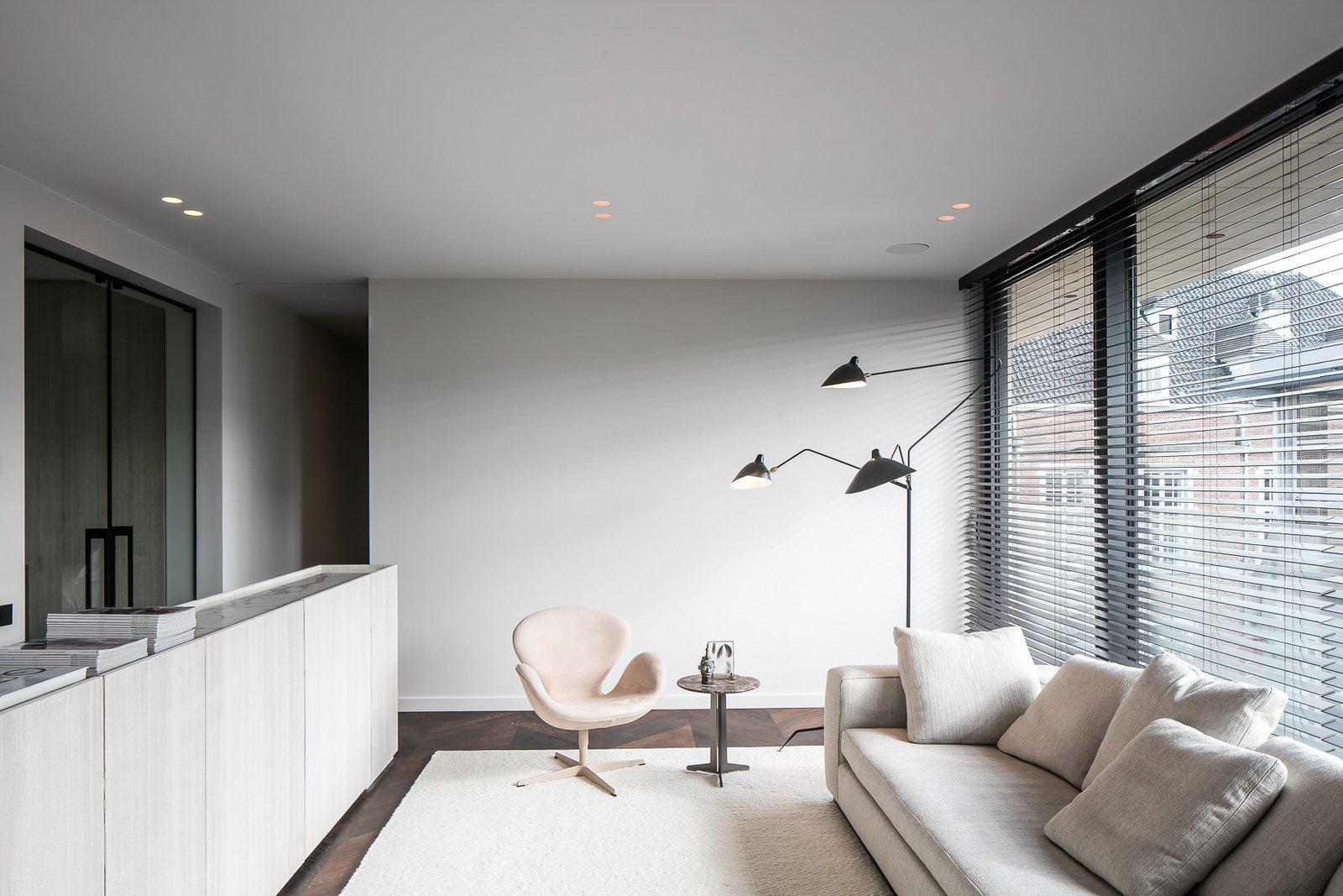 Living Room, Chair, Dark Hardwood Floor, Sofa, and Recessed Lighting  Penthouse O