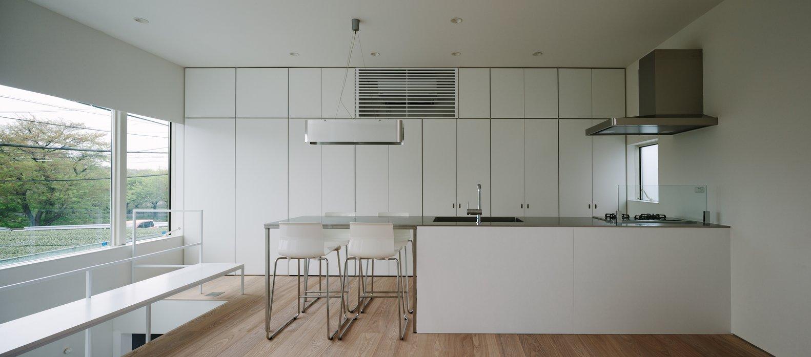Kitchen, Granite, White, Light Hardwood, Recessed, Range Hood, and Range  Best Kitchen Light Hardwood Granite Photos