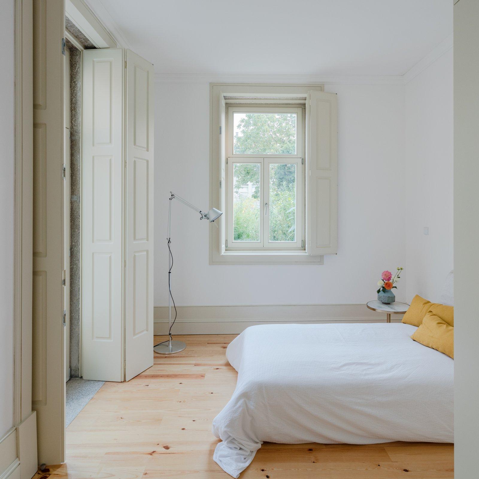 Bedroom and Light Hardwood Floor  Rua da Boavista