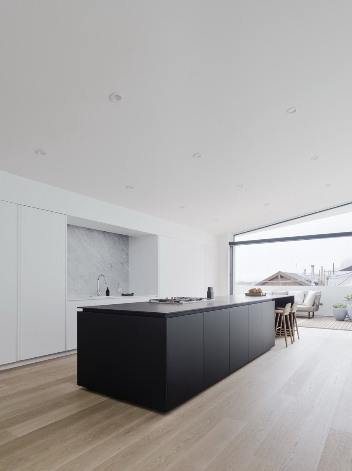 Kitchen, Marble Backsplashe, Recessed Lighting, and Drop In Sink  Switchback House