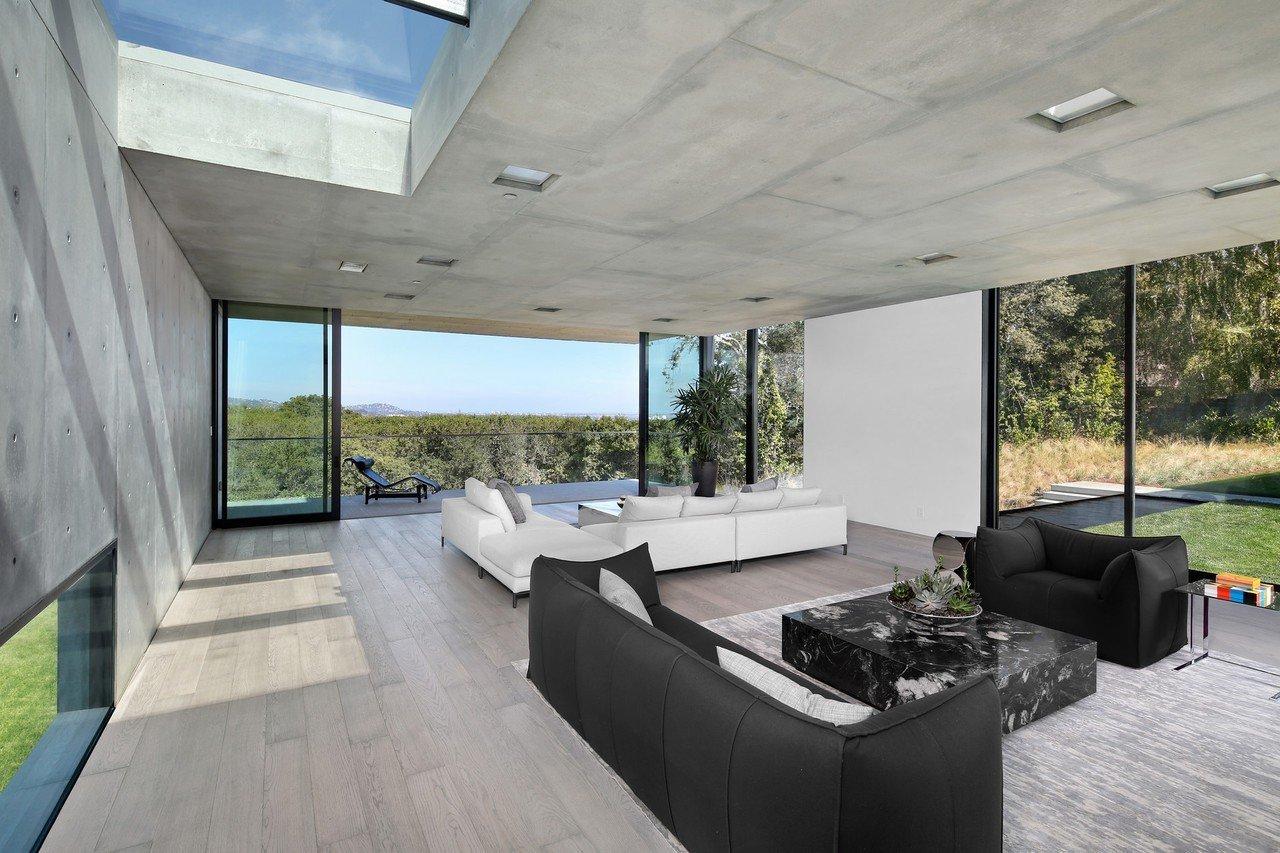 Living Room, Sofa, Ceiling Lighting, and Light Hardwood Floor  OZ Residence