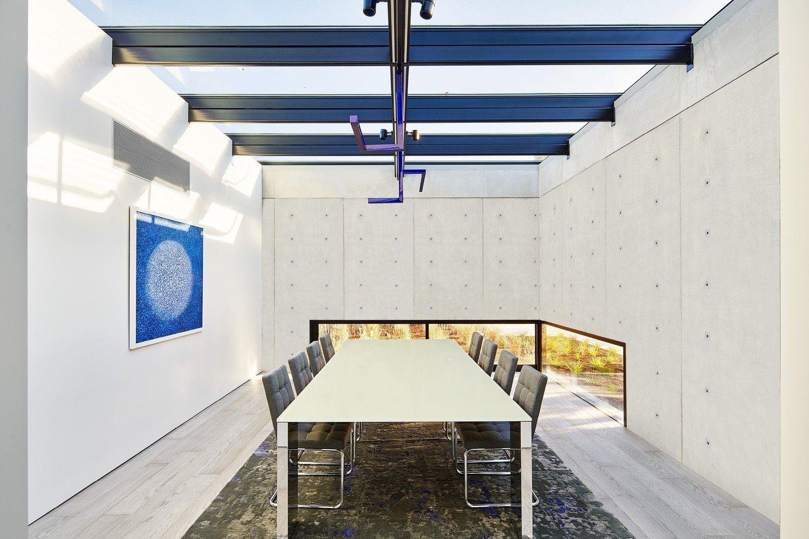 Dining Room, Chair, Light Hardwood Floor, Track Lighting, and Table  OZ Residence