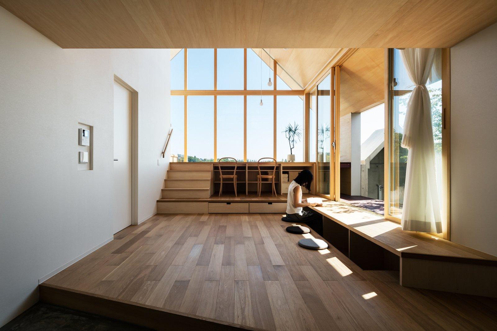 Living Room, Chair, and Medium Hardwood Floor  Newtown House