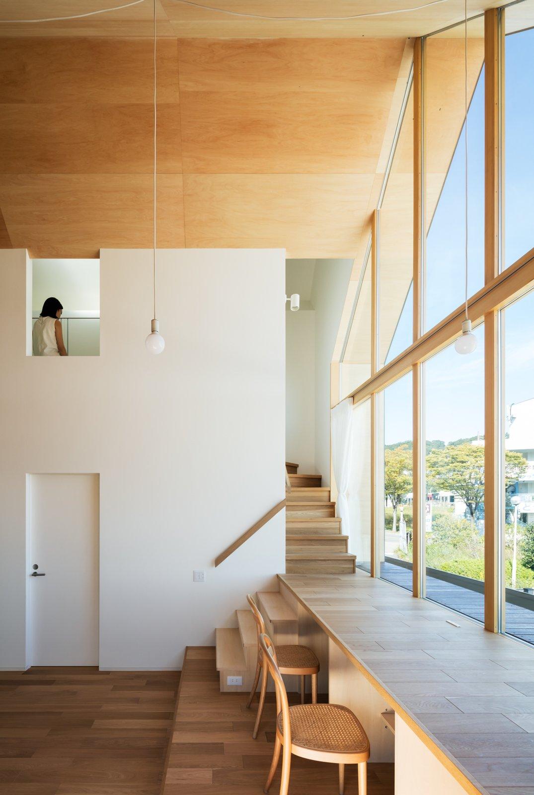 Living Room, Pendant Lighting, Medium Hardwood Floor, and Chair  Newtown House