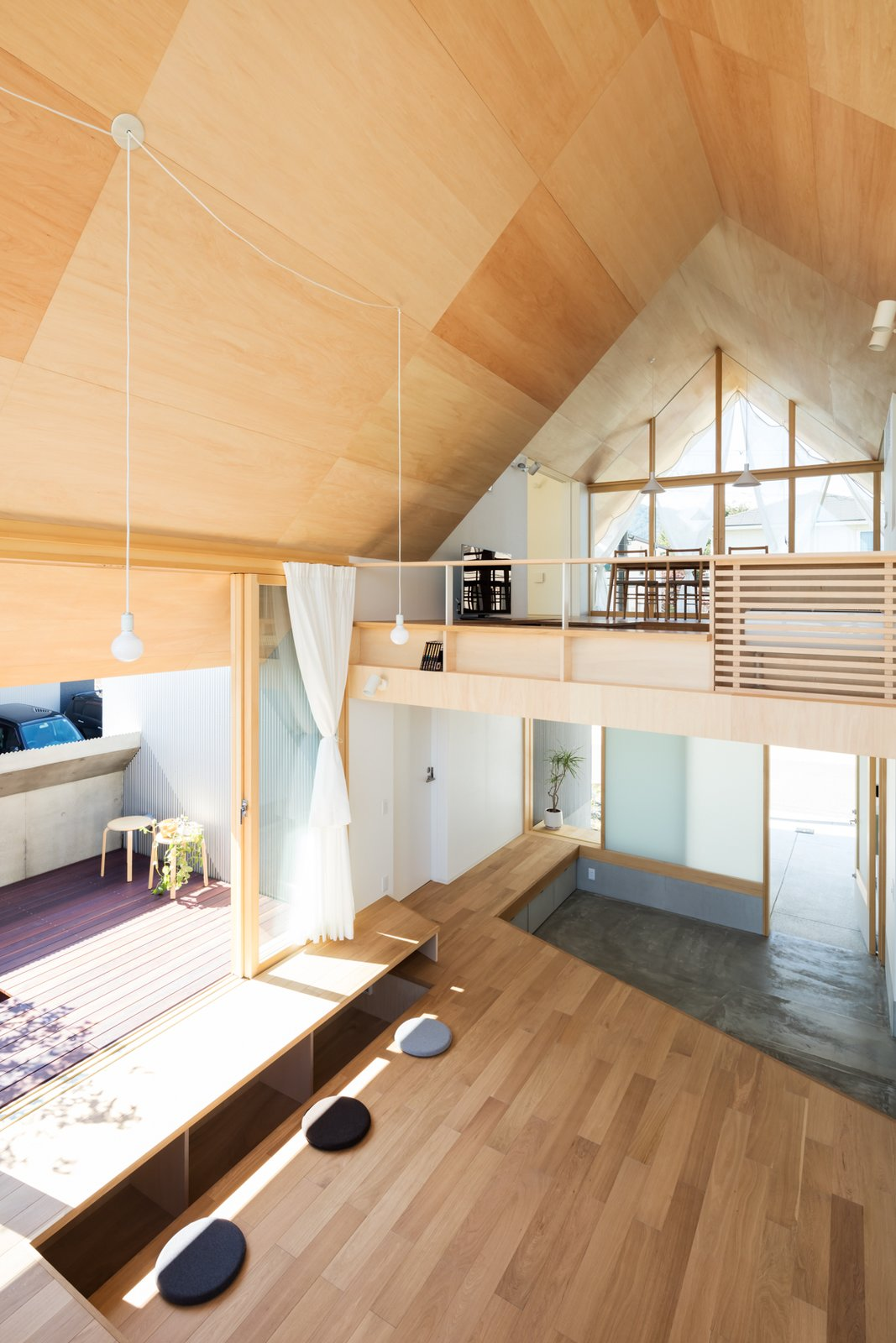 Living Room, Pendant Lighting, and Light Hardwood Floor  Newtown House